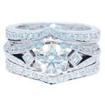 Elaborate antique inspired engagement ring with diamond set split wedding rings to make the completed design symmetical