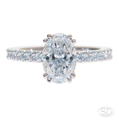 designer engagement ring with oval diamond