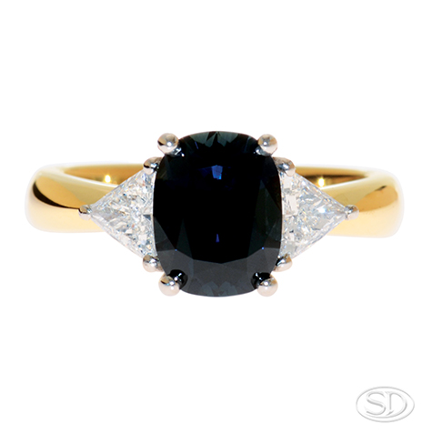 desiger Australian partii AKA teal sapphire ring with diamond shoulder made with yellow gold band