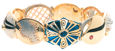 hand made Award winning hinged bracelet made of gold & titanium.